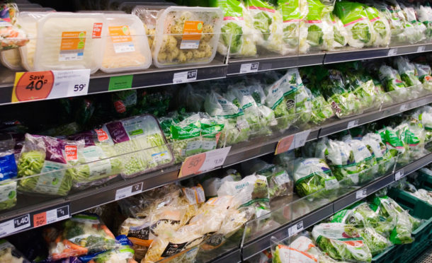 Supermarket, with produce heavily packaged in plastic